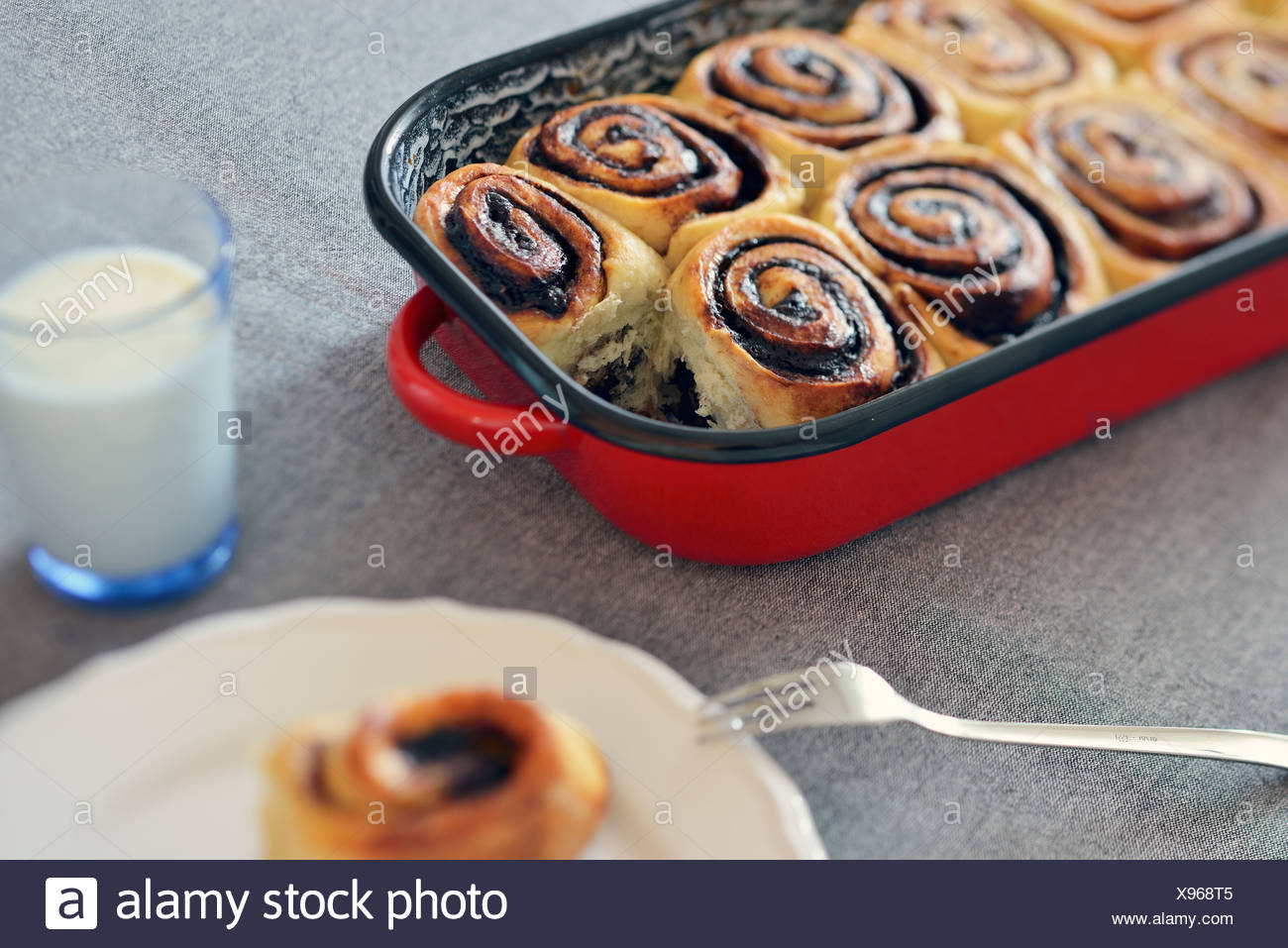 Cocoa sticky buns in casserole dish - Stock Image