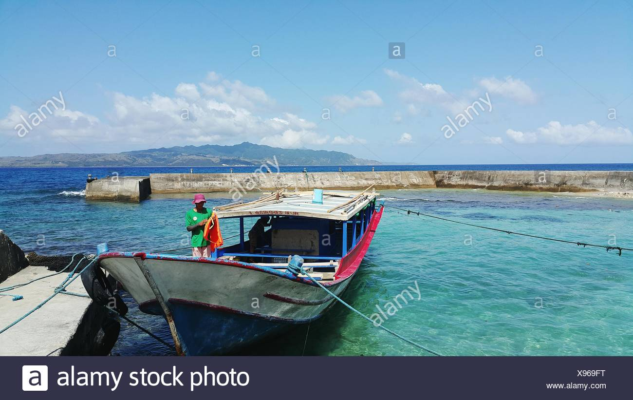 Two Men On Anchored Fishing Boat - Stock Image