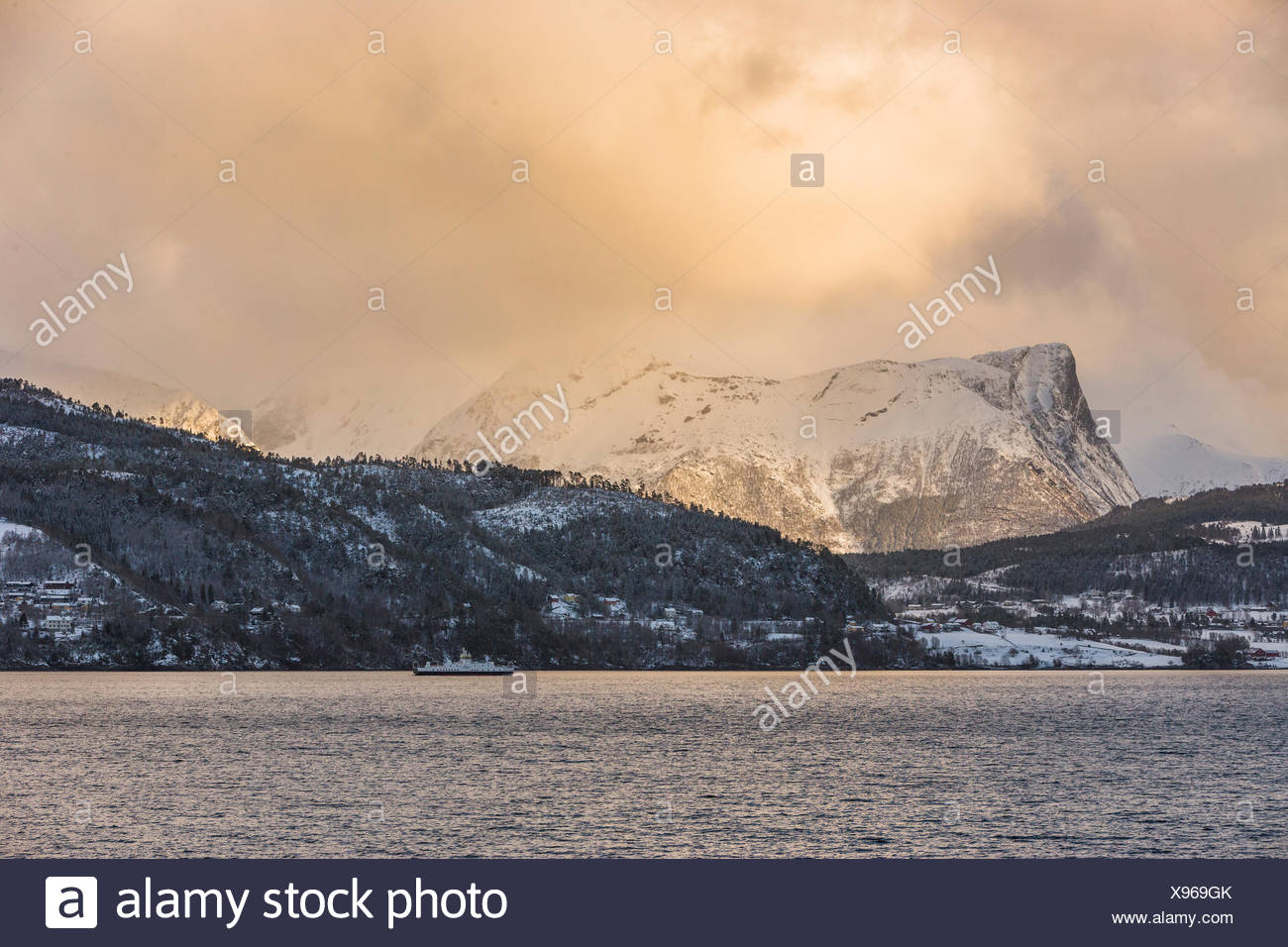 The Volda fjord at sunset in winter - Stock Image
