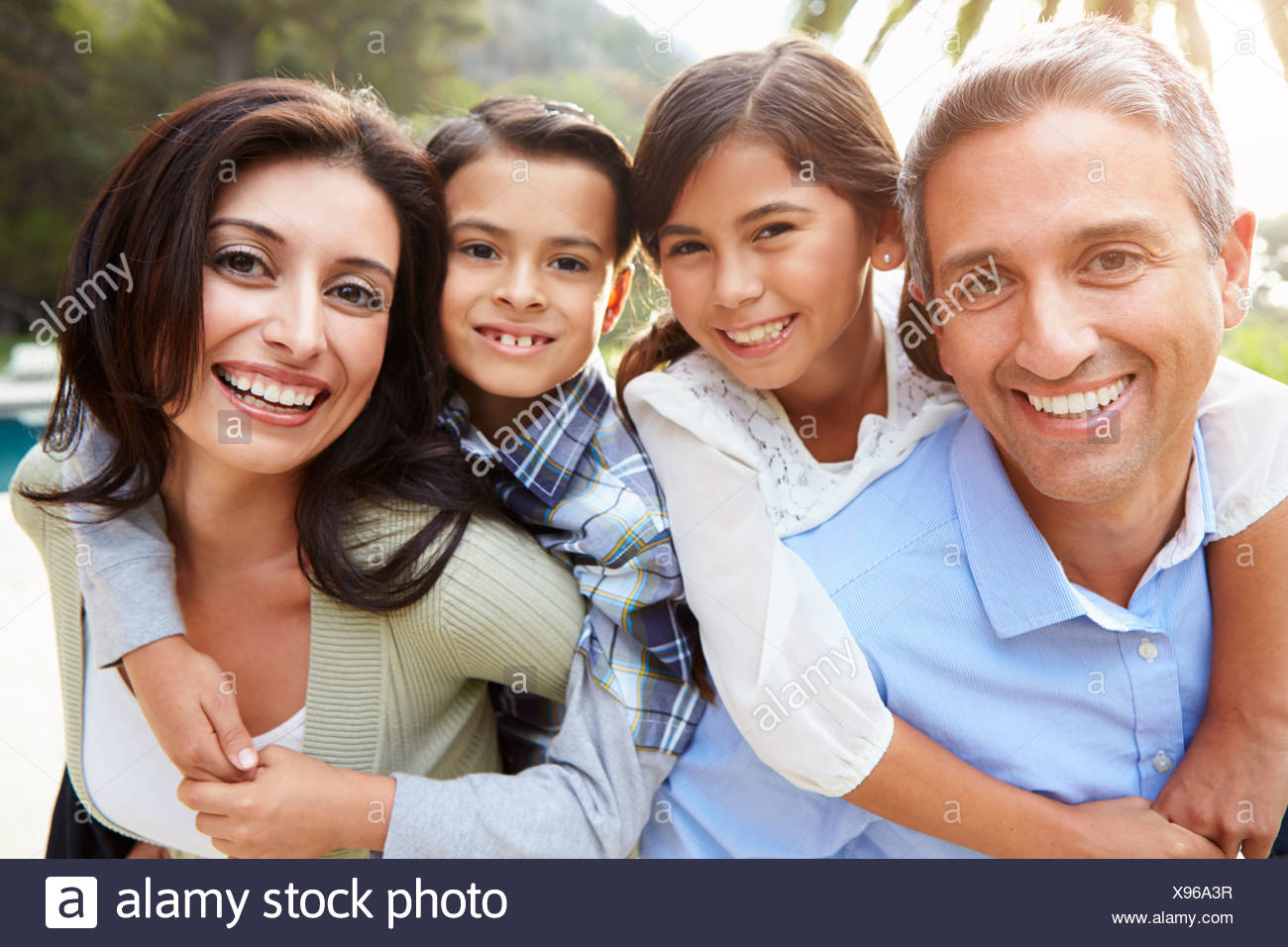 Portrait Of Hispanic Family In Countryside - Stock Image