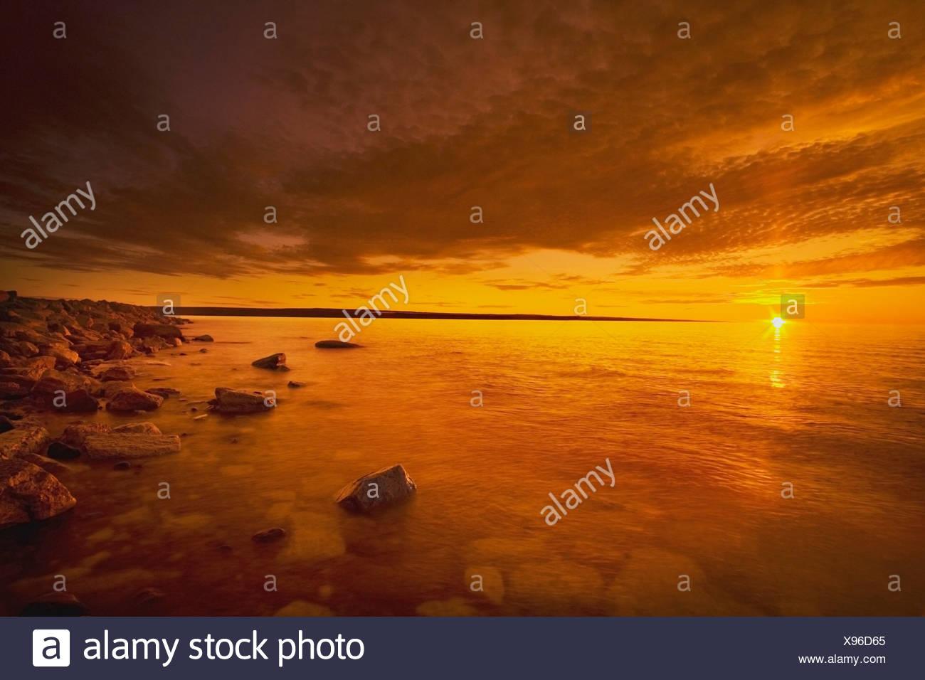 Northwest Territories, Canada; Coastline Of The Arctic Ocean At Sunset - Stock Image