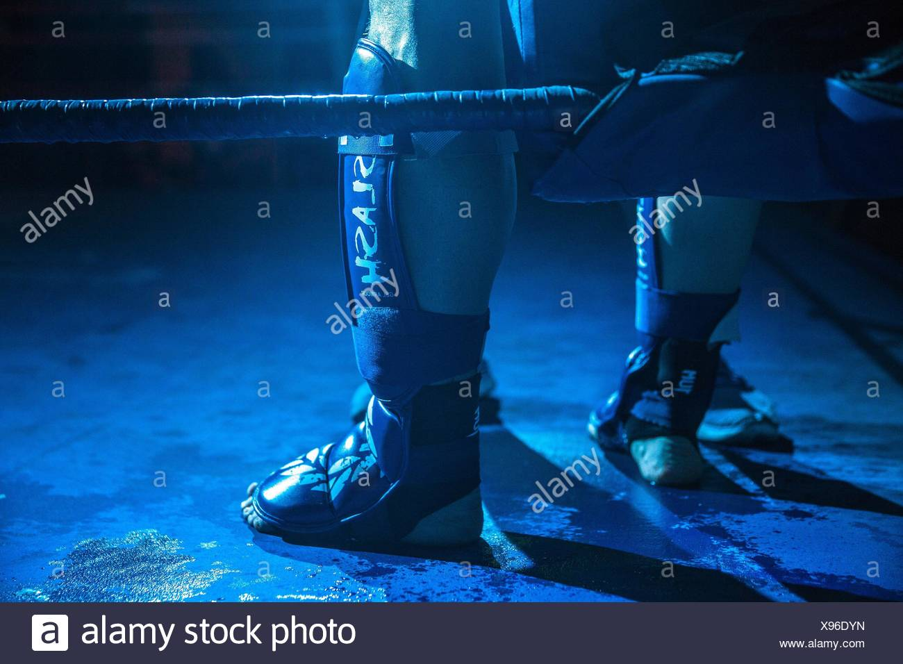 male versus male kickboxing match - Stock Image
