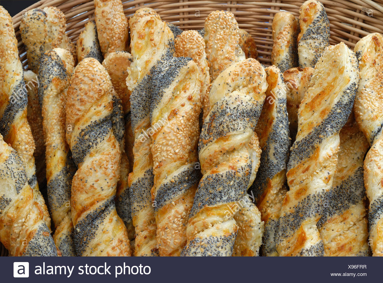 Poppyseed sticks (mini baguettes) in a basket Stock Photo