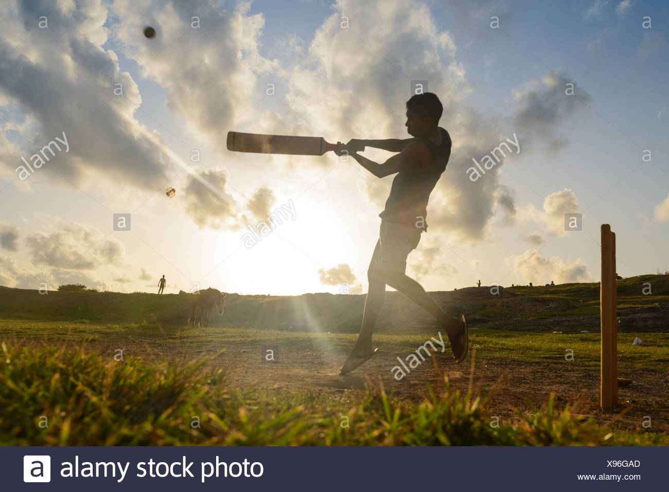 Silhouette of a man playing cricket, Galle, Sri Lanka - Stock Image