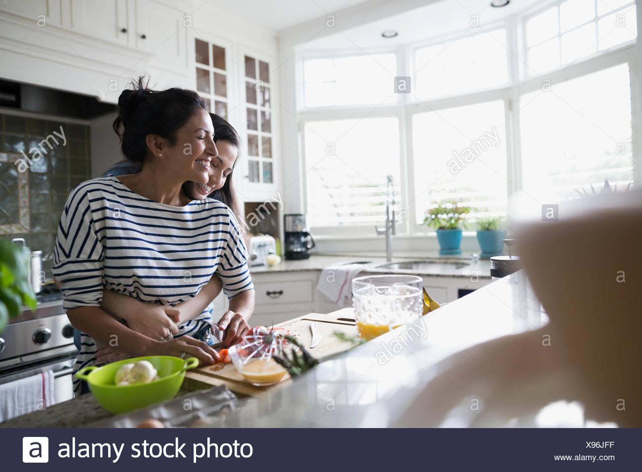 Hispanic Mother Cooking In Kitchen Stock Photos & Hispanic Mother ...
