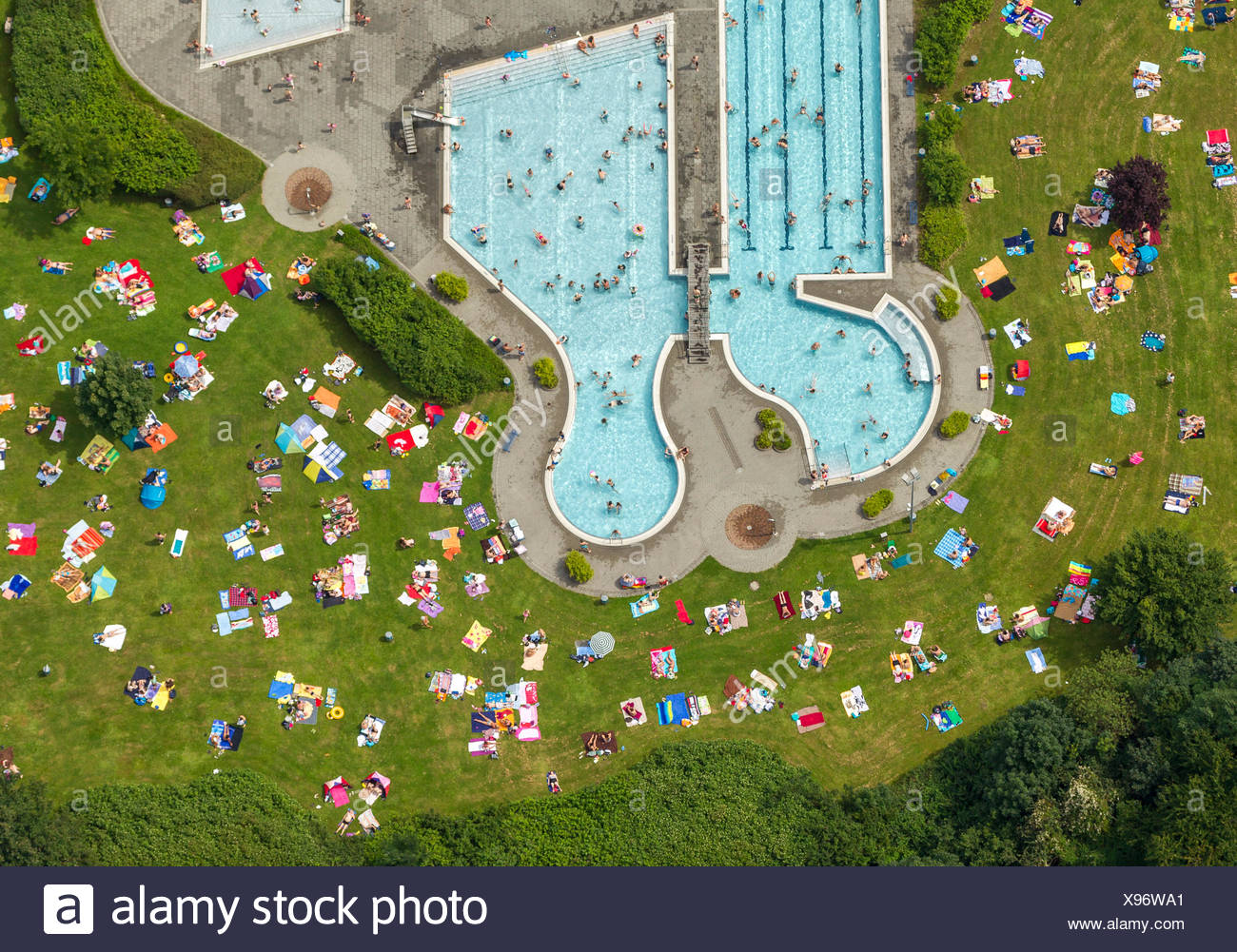 Aerial view, lawn for sunbathing with the southern pool of the outdoor swimming centre, Herne, Ruhr Area - Stock Image