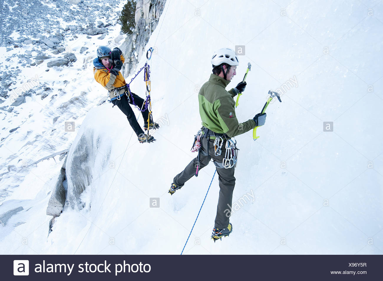 A photographer photographs an ice climber in Calif. Stock Photo
