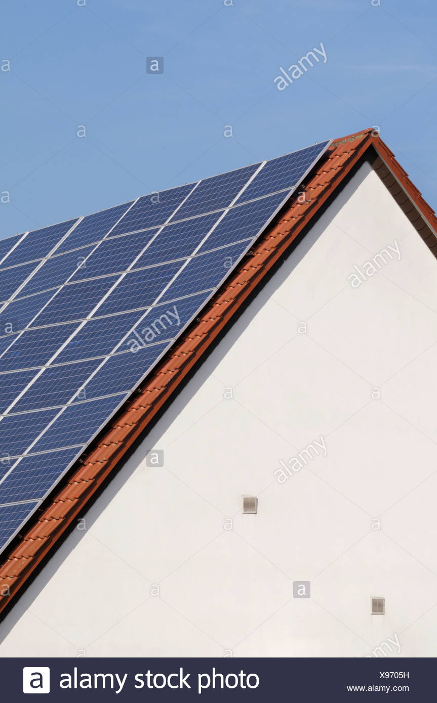 Solar collectors on a roof - Stock Image
