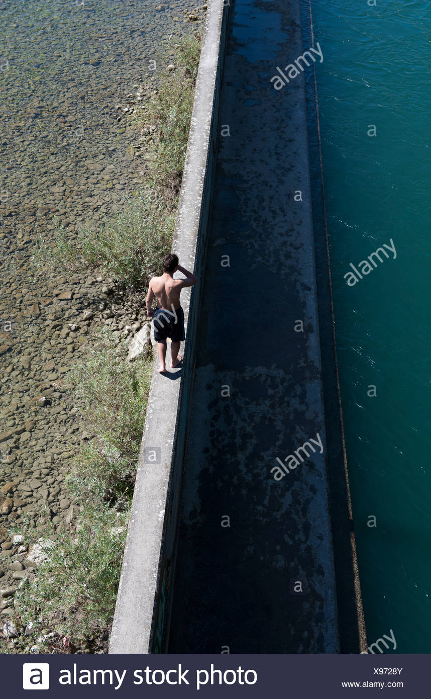 Zurich, Switzerland, a visitor at the poolside from Flussbad Unterer Letten - Stock Image