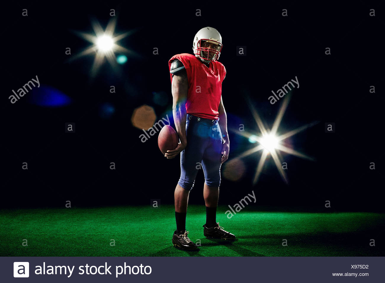American football player with ball - Stock Image