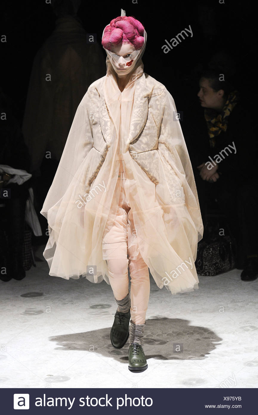 Comme des Garcons Paris Ready to Wear Autumn Winter Knee length flesh coloured multi layered tulle coat, matching shorts and - Stock Image