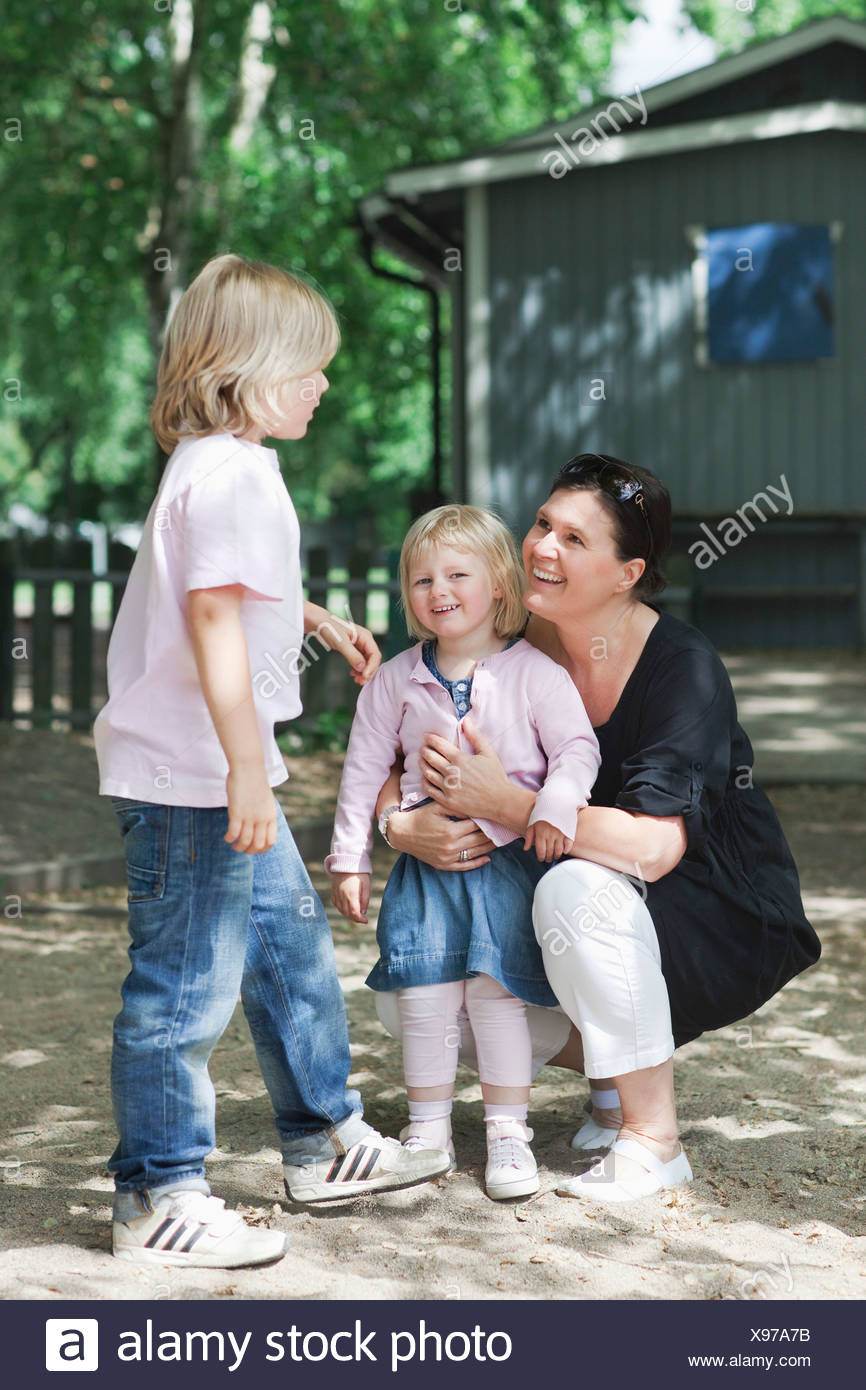 Mother with two kids - Stock Image