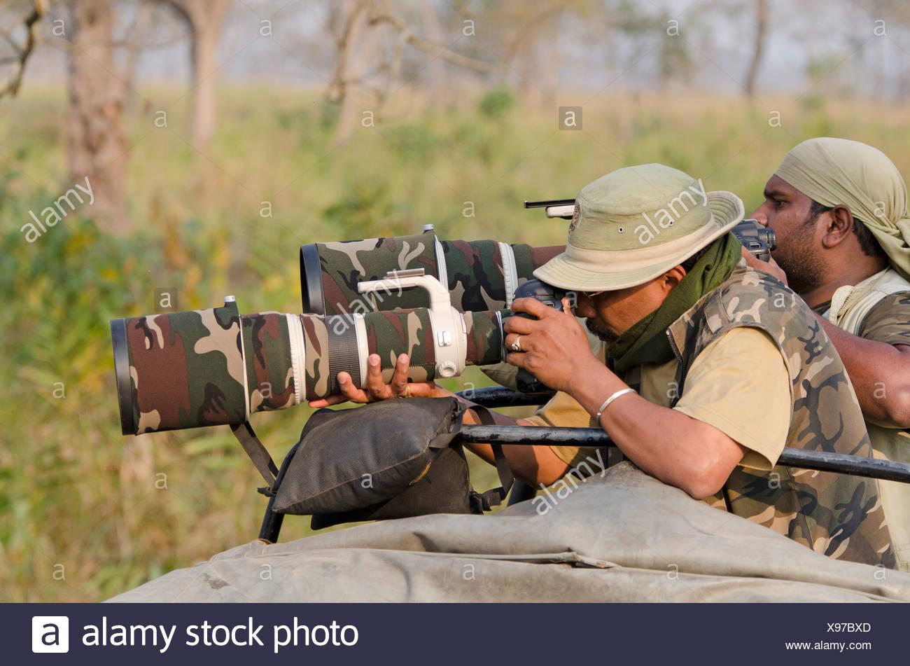 Indian wildlife photographers with telephoto lenses, Kaziranga National Park, Assam, Northeast India, India, Asia - Stock Image