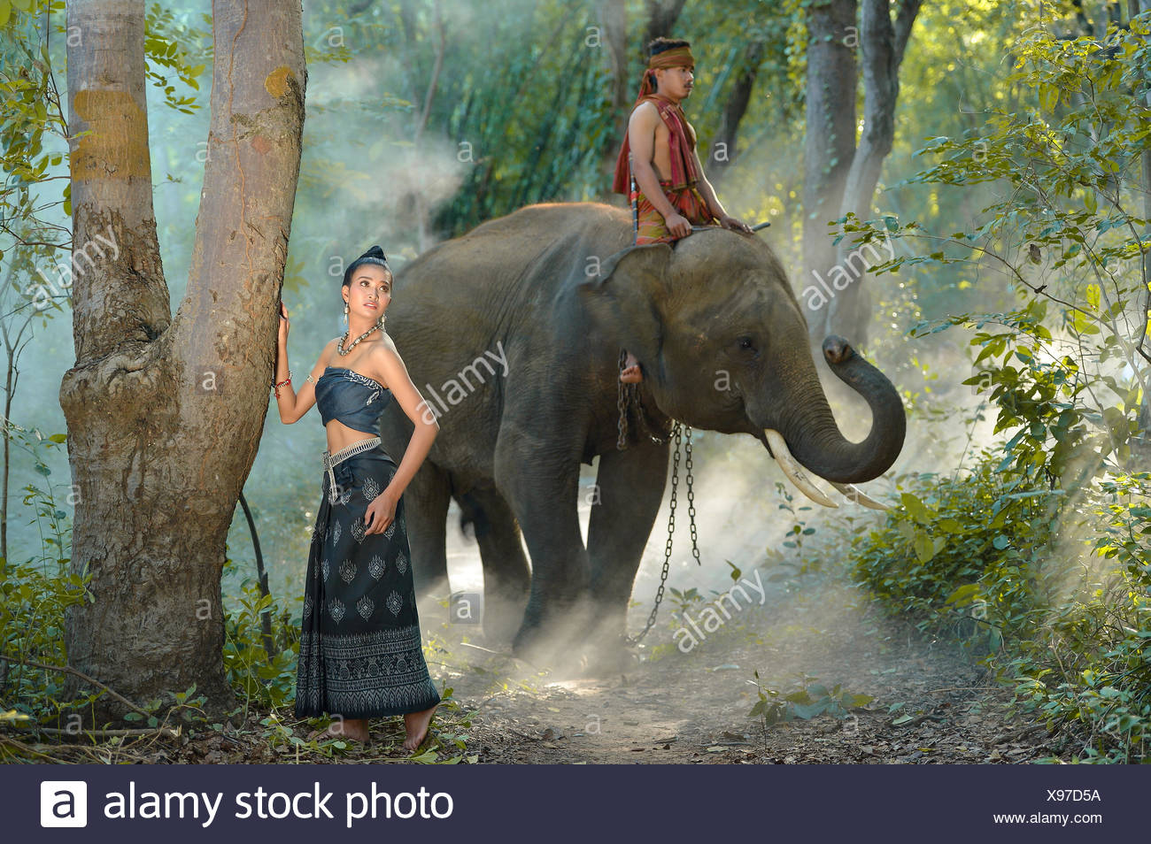Beautiful nude woman riding an elephant