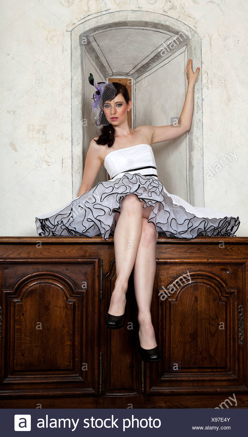 Young woman wearing a headdress and a white dress - Stock Image