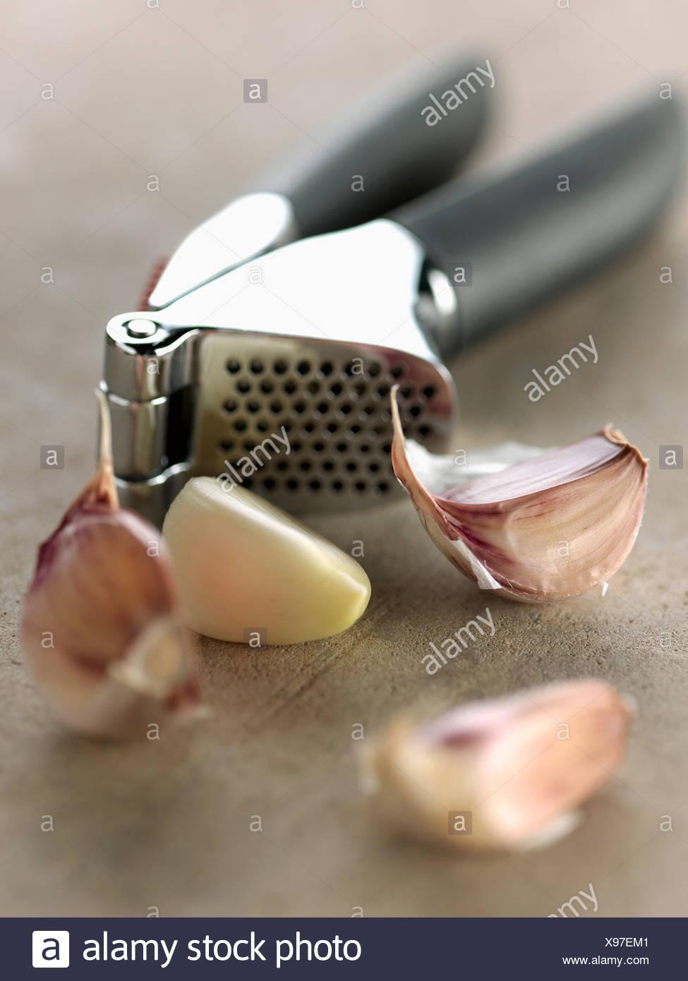 Garlic crusher - Stock Image
