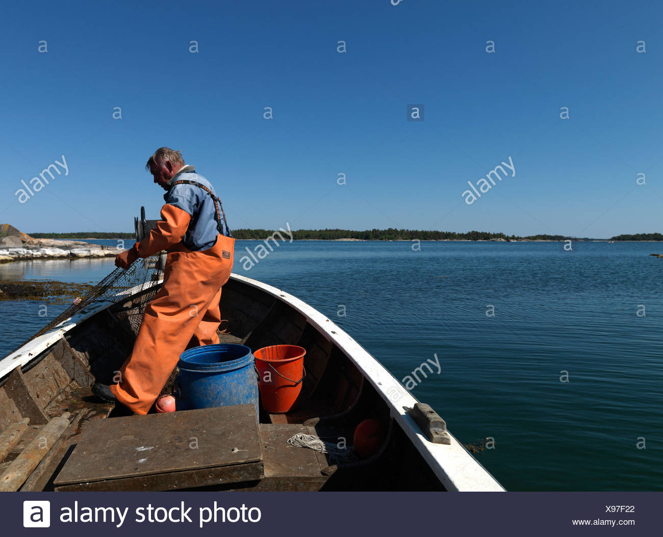 A fishing man in a boat Sweden. Stock Photo