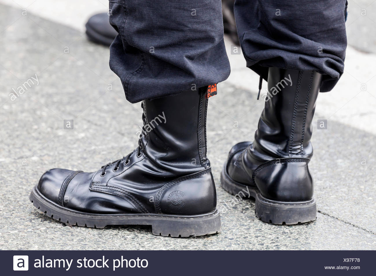 Member of a right-wing Hungarian party wearing combat boots, symbolic image for right-wing extremism, Budapest, Hungary - Stock Image