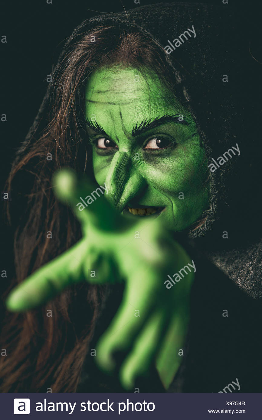 Evil witch casting a curse - Stock Image