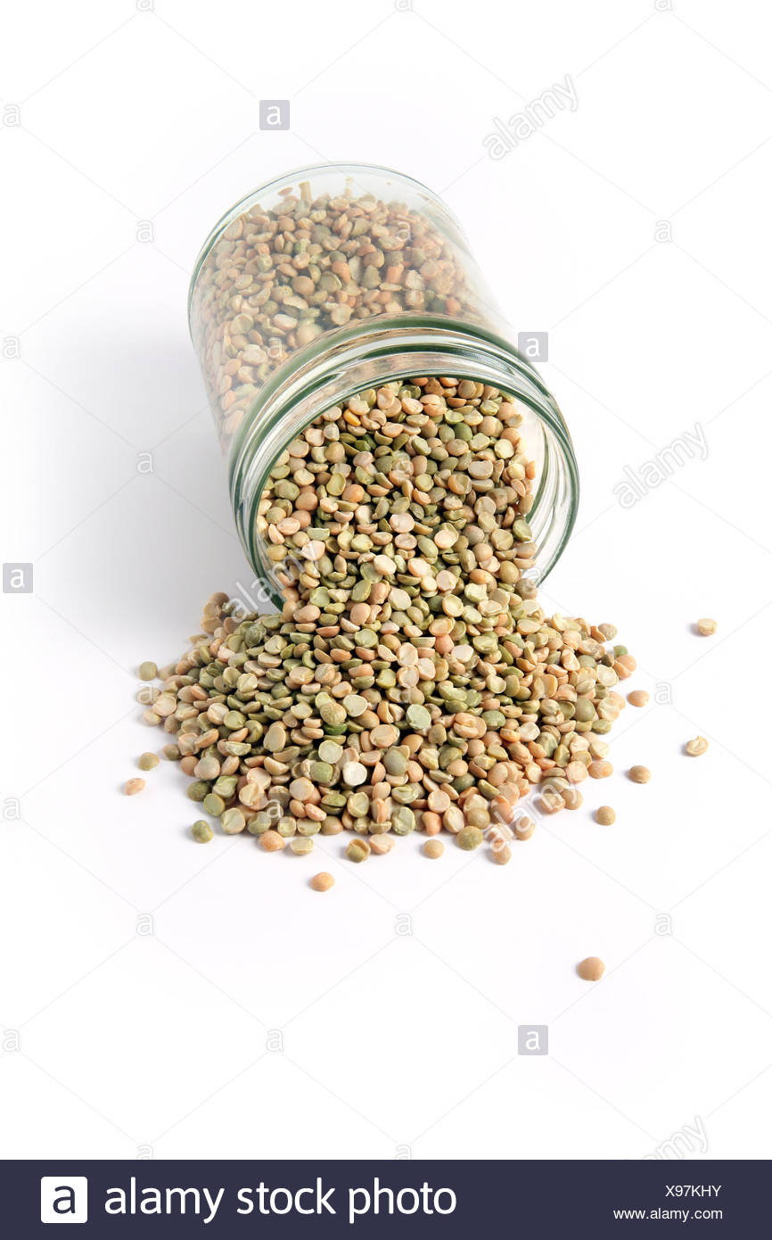 food aliment vertical raw reversed split peas in an open jar on a white - Stock Image