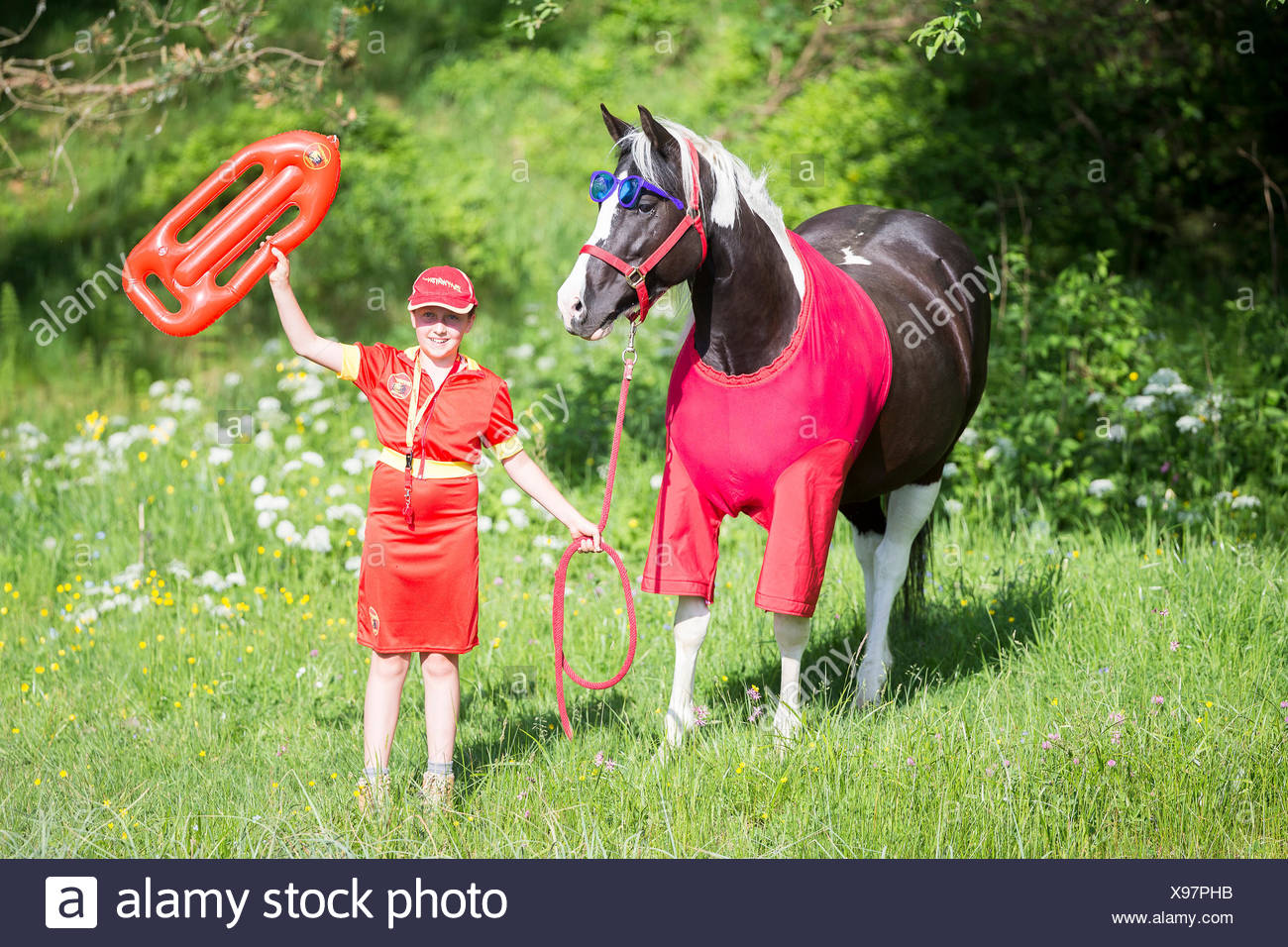 American Paint Horse Child And Horse In Lifeguard Costumes Baywatch Austria Stock Photo Alamy
