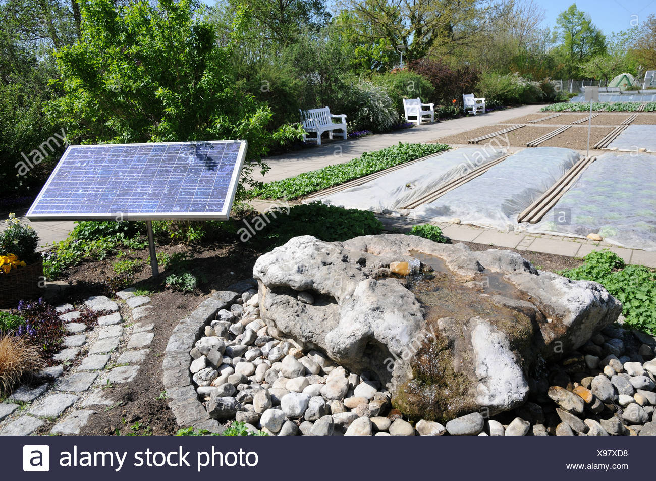 Bubbling water with sun-energy - Stock Image