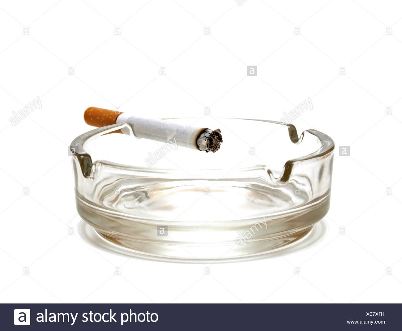 cigarette at ashtray - Stock Image