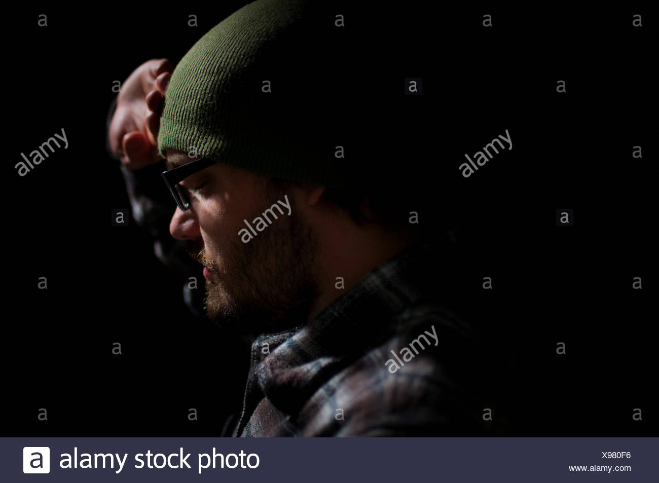 USA, Idaho, Boise National Forest, Long Creek Road, Profile of man in darkness - Stock Image