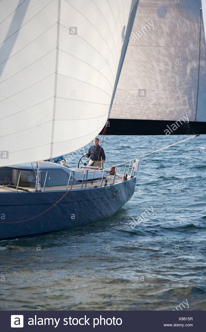 A crew races a modern ocean-going sailing yacht. Stock Photo