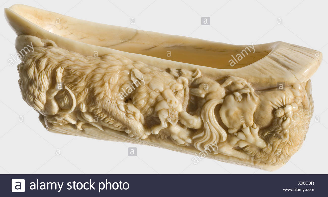 A kovsh with hunting motifs, Russia(?), 18th/19th century. Made of a narwhal tusk, finely carved with wild beasts and hounds entwined in fight. Length 14 cm, weight 230 g. Excellent carving made from the tusk of a major narwhal. historic, historical, 19th century, 18th century, handicrafts, handcraft, craft, object, objects, stills, clipping, clippings, cut out, cut-out, cut-outs, fine arts, art, artful, Additional-Rights-Clearences-NA - Stock Image