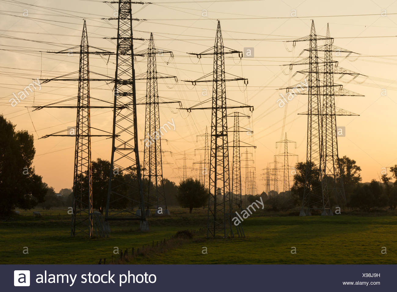 Overhead cables in a landscape - Stock Image