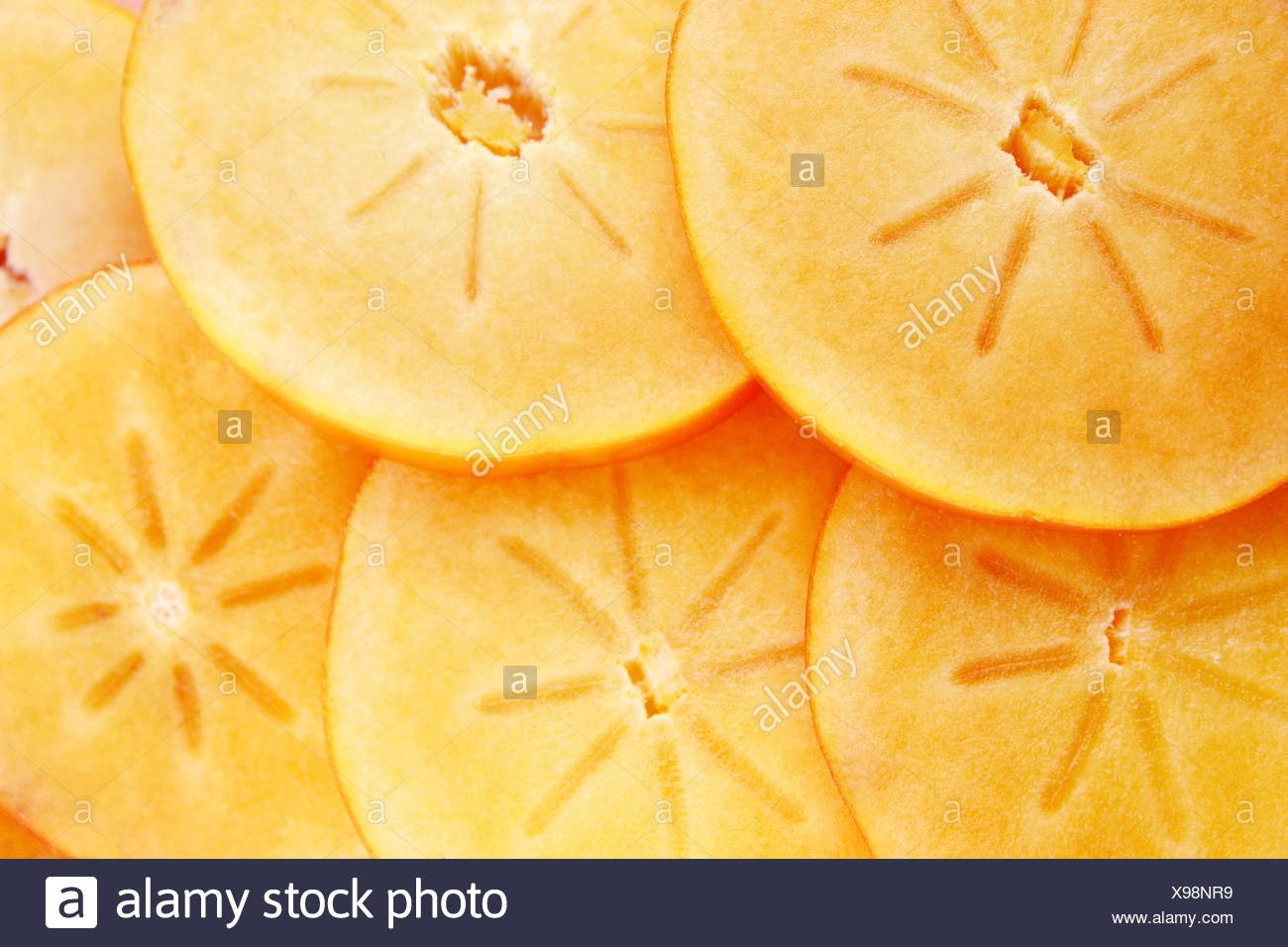 persimmon fruit slices - Stock Image