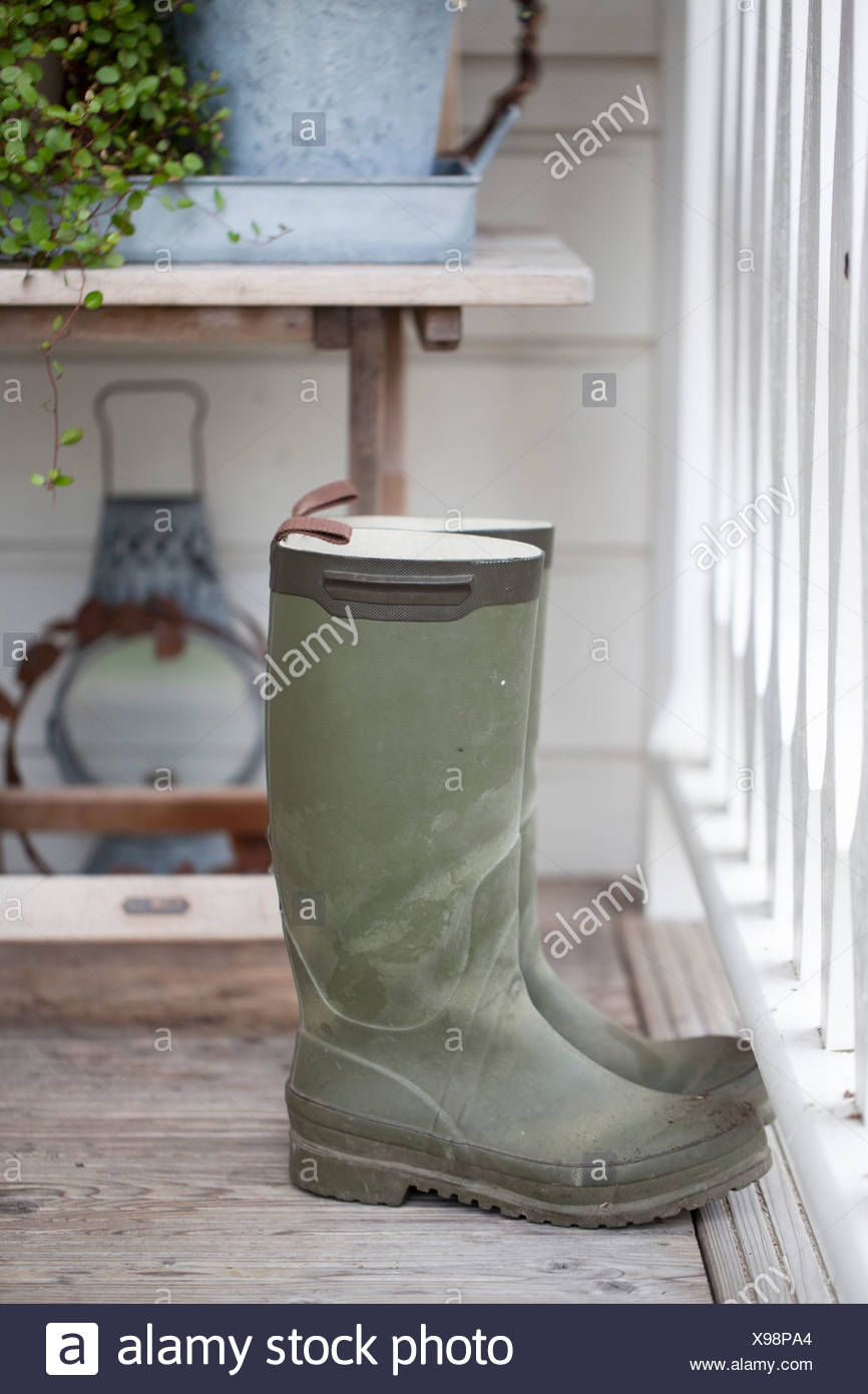 Rubber boots by railing Stock Photo