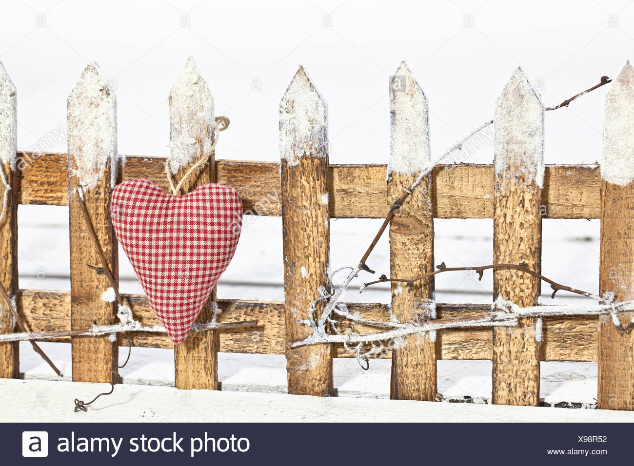 Deko fence and checked heart - Stock Image
