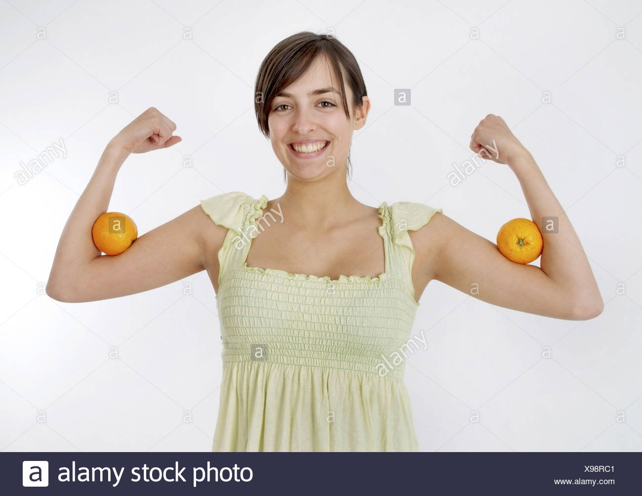 woman with oranges, power with vitamins - Stock Image