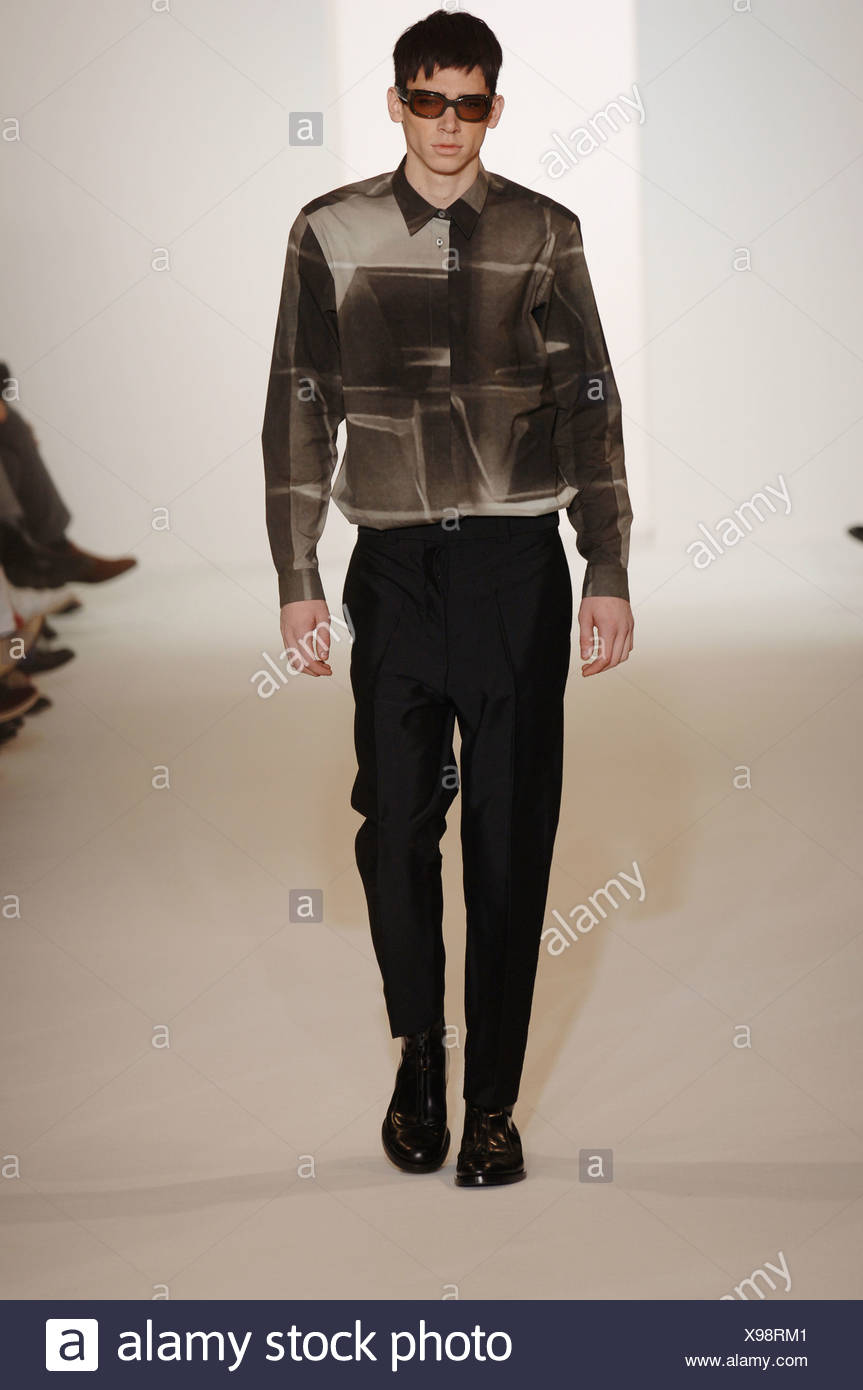 Marni Milan Ready to Wear Autumn Winter  Two tone print shirt and tapered black trousers, accessorized tinted shades and black - Stock Image