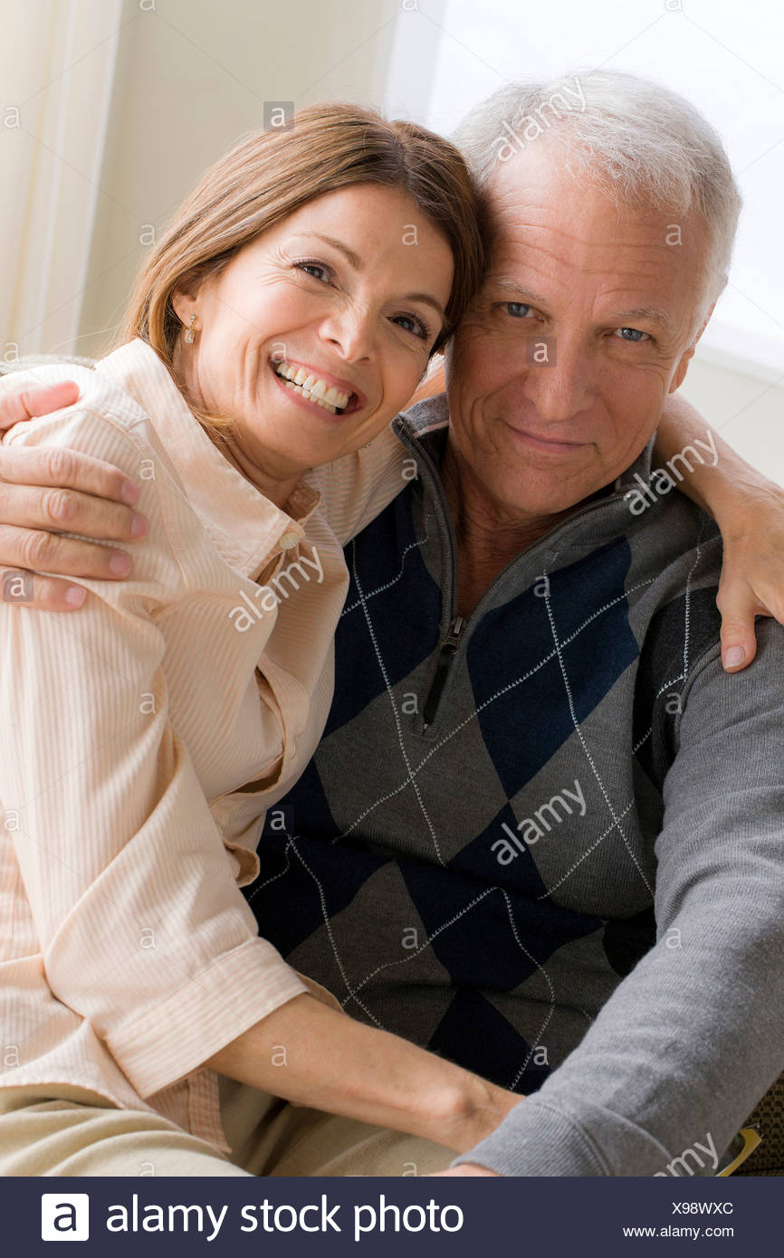 Mature woman and senior man hugging - Stock Image