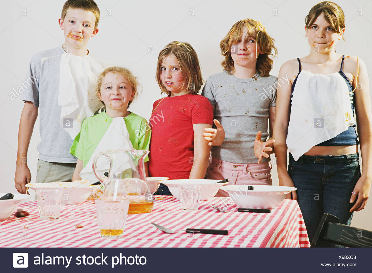 Messy children looking guilty - Stock Image