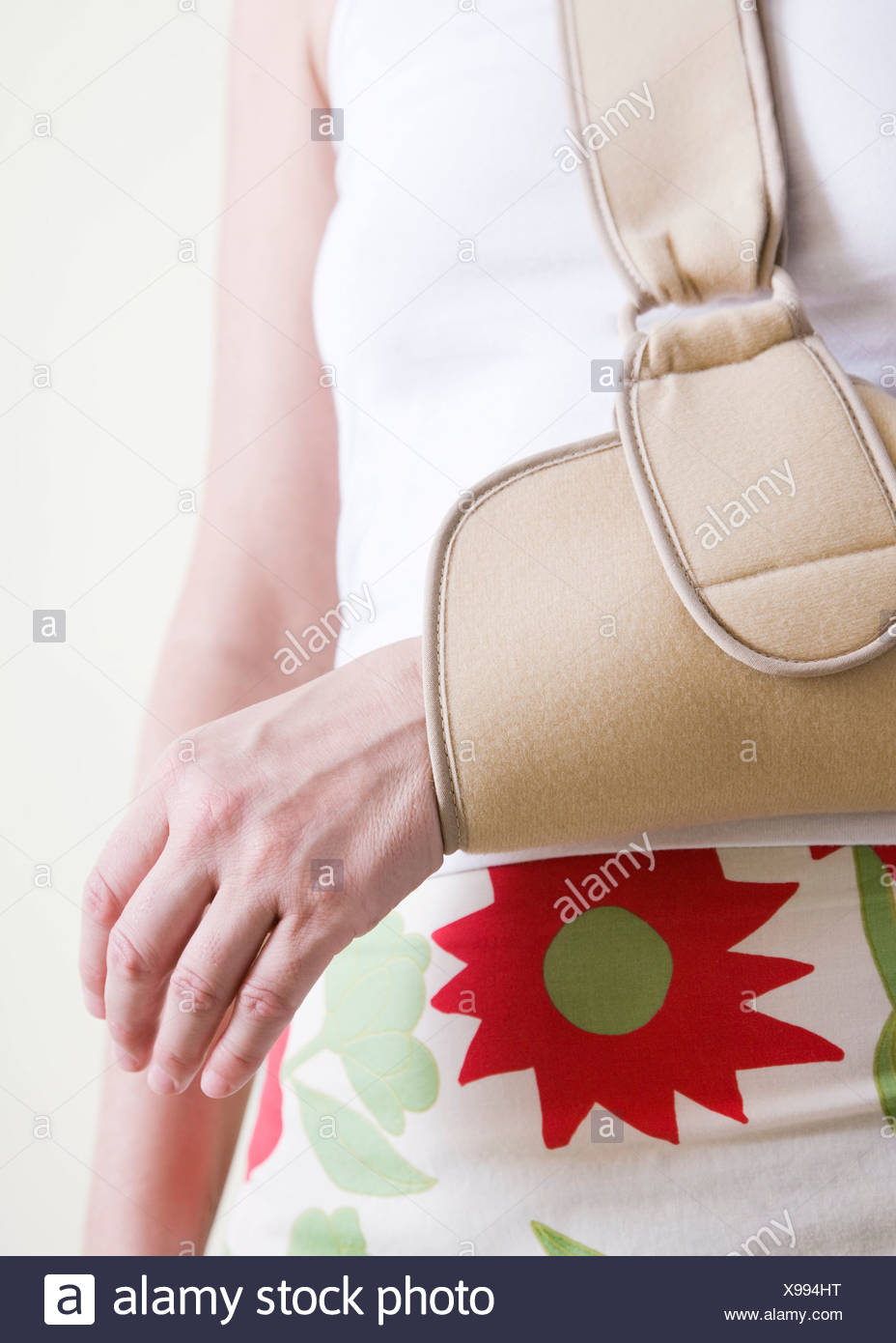 Arm in a sling - Stock Image
