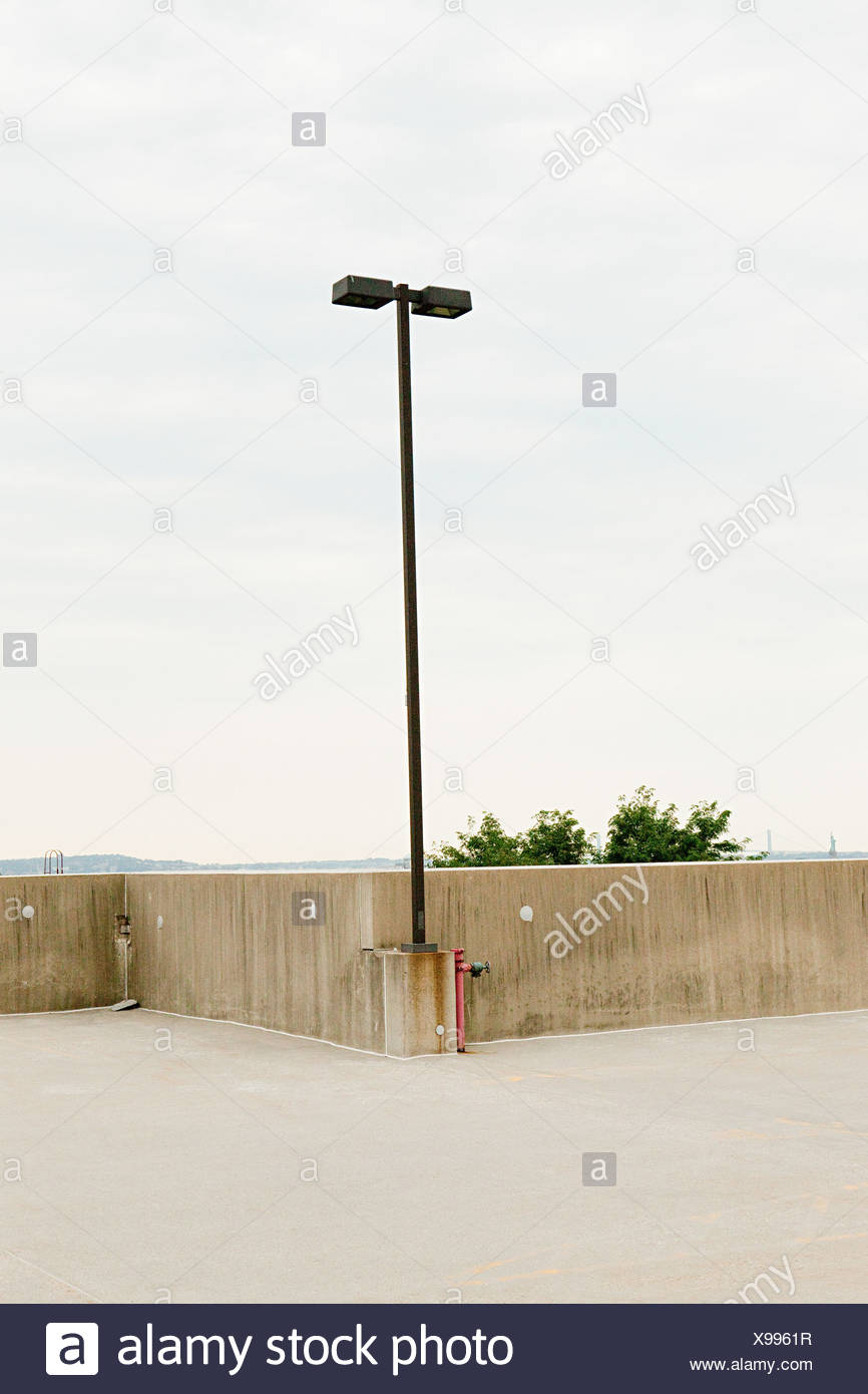 Empty car park with lamp post - Stock Image