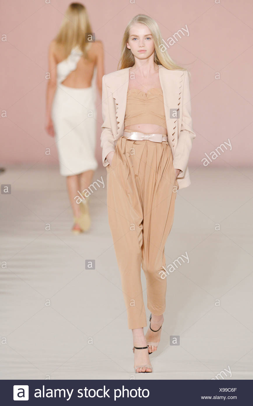 91fb364ac166 Chloe Paris Ready to Wear Spring Summer Model wearing pale peach high  waisted gathered trousers