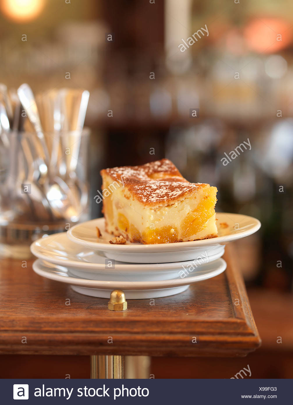 Portion of apricot batter pudding Stock Photo