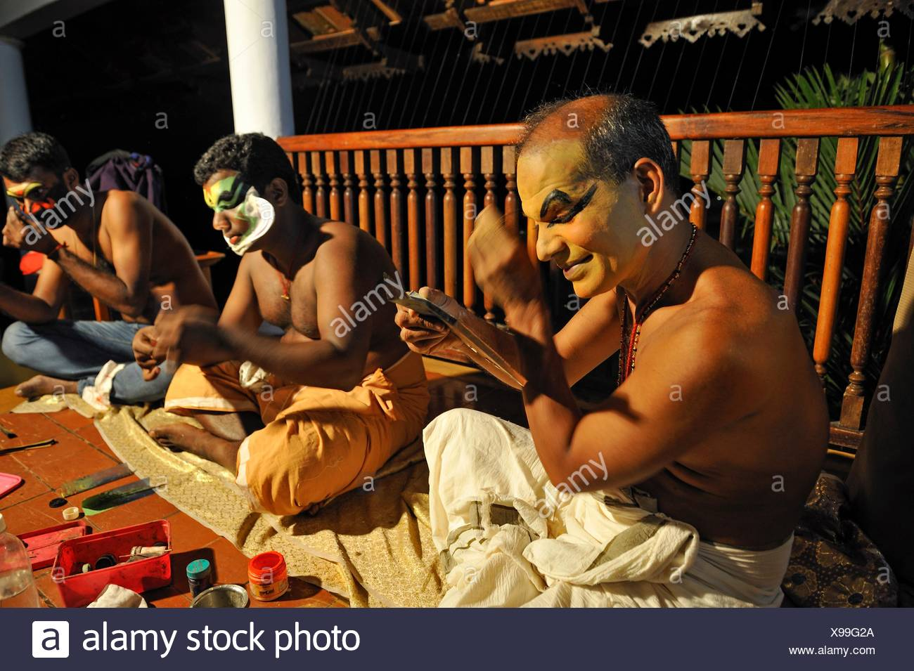 Kathakali performers during making up before a show at the Kumarakom Lake Resort hotel, Kerala state, South India, Asia. Stock Photo
