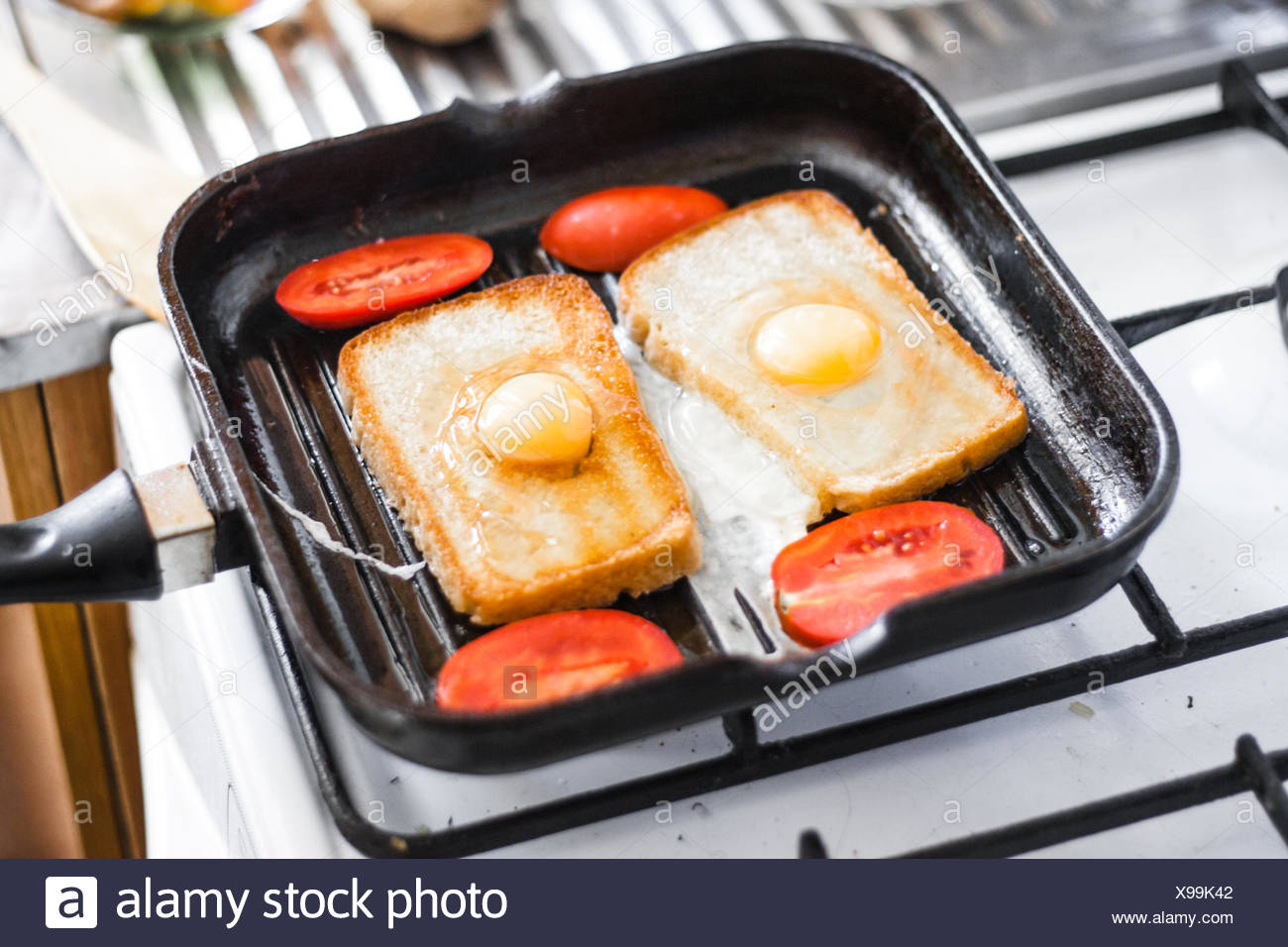 Fried egg in a frying pan - Stock Image