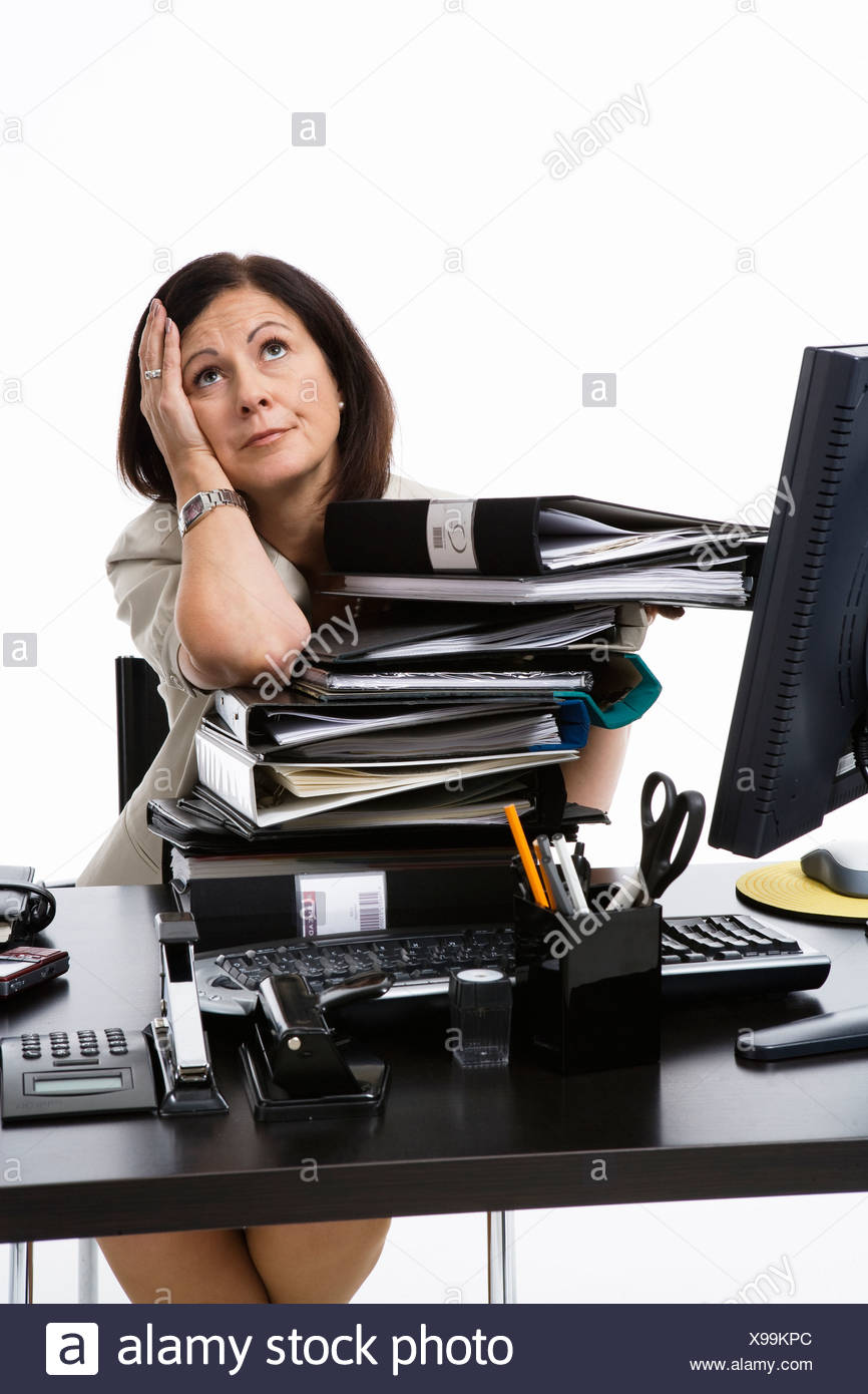 Businesswoman in an office. - Stock Image
