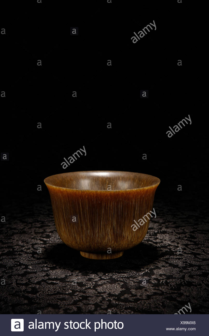 Carved rhinoceros horn cup Stock Photo
