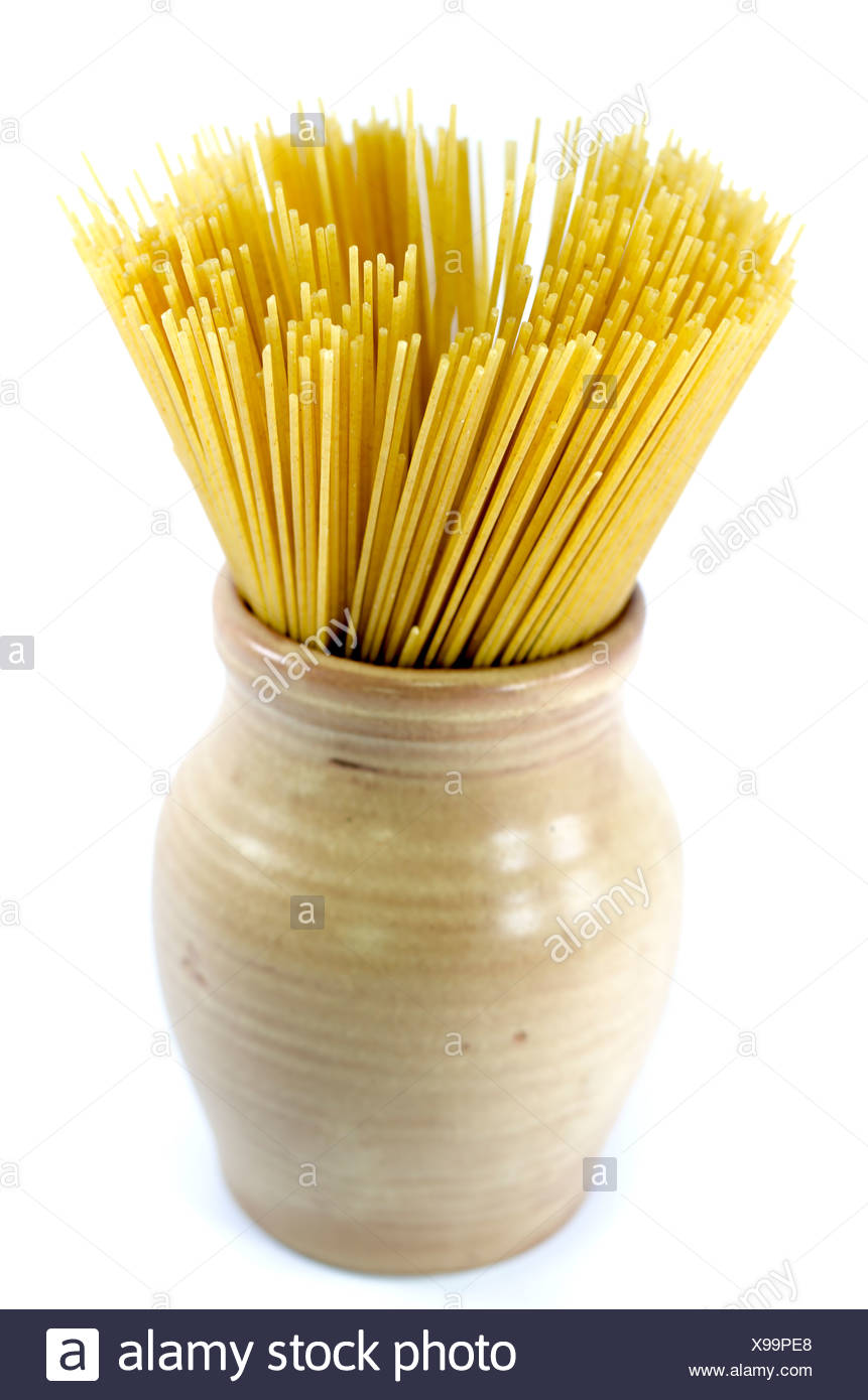 uncooked spaghetti in an earthenware pot. - Stock Image