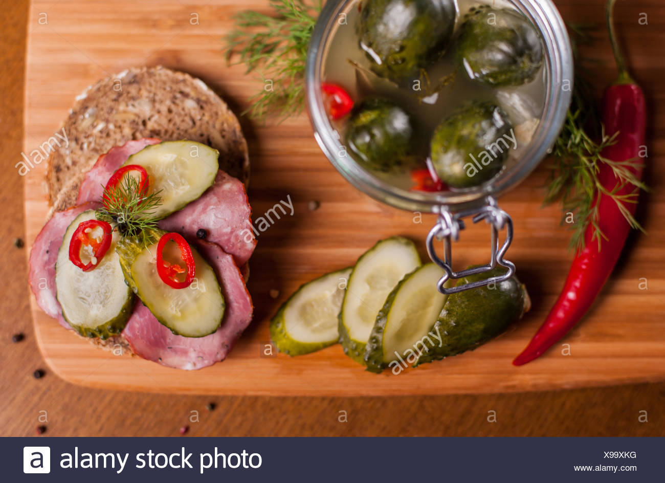 Sandwich with homemade products on cutting board. Debica, Poland - Stock Image
