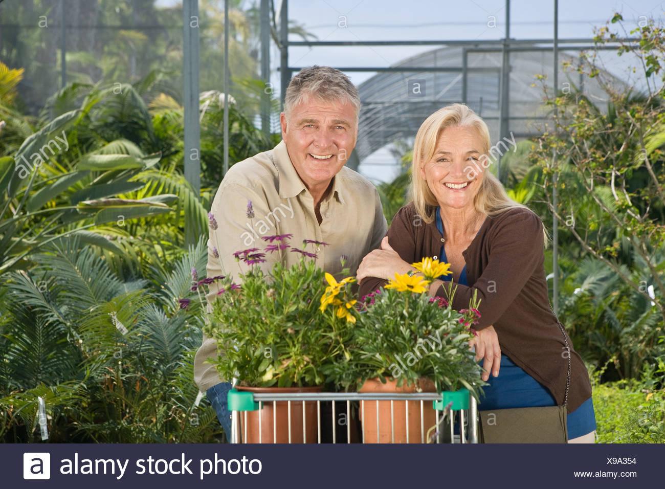 Couple shopping in garden centre - Stock Image