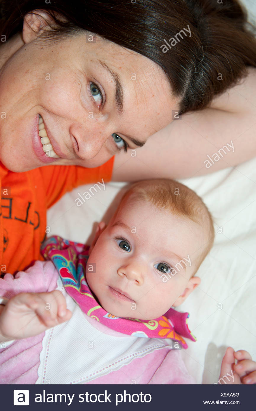 Mother and child, baby girl, four months, attentively - Stock Image
